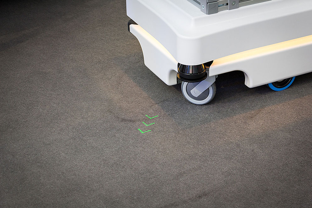 Robot colleagues communicate their destination via laser projection